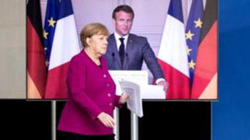 Macron, Merkel float 'ambitious' EU virus fund