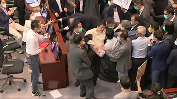 Lawmakers carried out during Hong Kong parliament mayhem