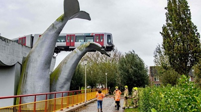 Whale's tail sculpture saves train from crashing