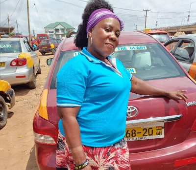 Ms Edith Awuah —  teacher earning living as cabbie