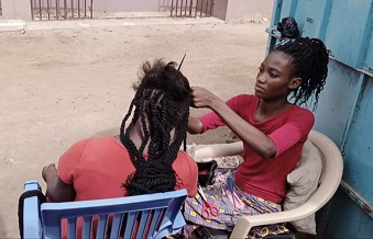 Disabled braids hair to raise funds for Surgery