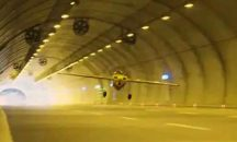 Stunt pilot sets Guinness World Record for longest flight through tunnel